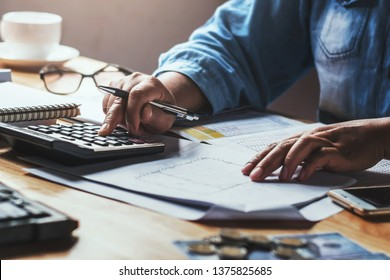 businesswoman working with using calculator in office