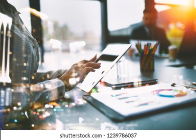Businesswoman works in office with a tablet. Concept of internet sharing and company startup. double exposure