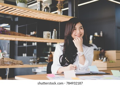 businesswoman write note on notebook at workplace. startup woman working with business plan report document at office.  young female entrepreneur analyze accounting market data.  financial