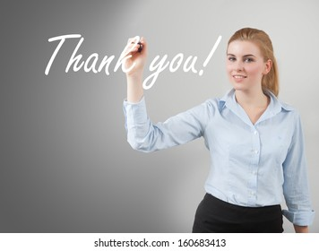 businesswoman write 'thank you' on glass