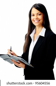 Businesswoman writing in her organizer and smiling, isolated on white