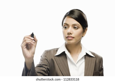 Businesswoman writing on a blank space against a white background