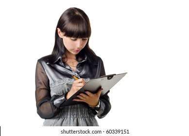 Businesswoman writing in a pad. isolated over white
