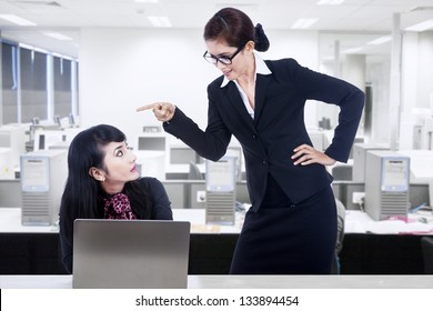 Businesswoman is yelling at her employee