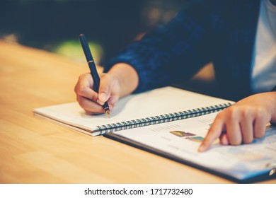 Businesswoman's hand showing diagram on financial report with pen. Summary Report concept