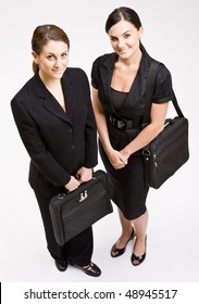Businesswomen carrying briefcases