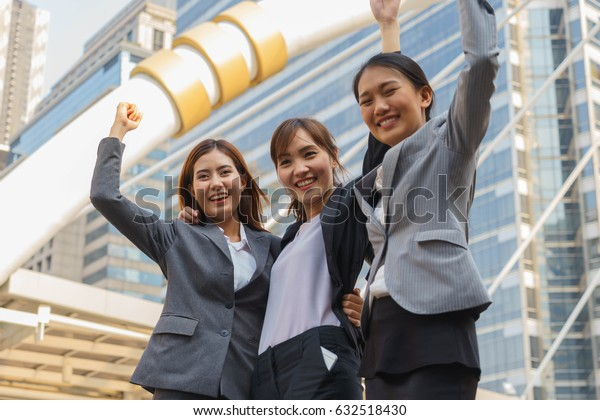 Businesswomen are celebrating for their success.