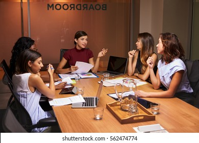 Businesswomen at an evening meeting in a boardroom