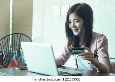 Businesswomen hands holding a credit card and using laptop for online shopping.selective focus.