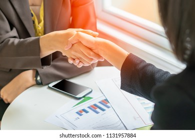 businesswomen handshaking after signing a contract of a good deal