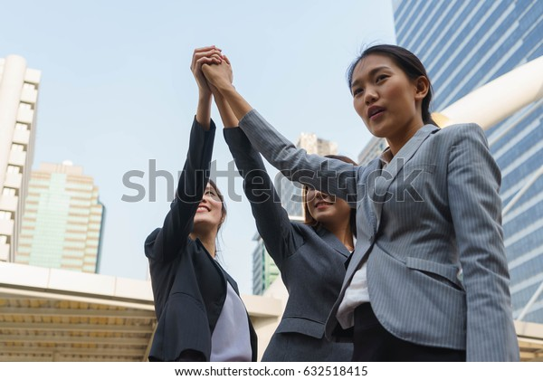 Businesswomen are having commitment together.