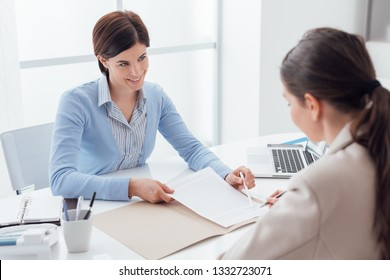 Businesswomen meeting in the office, the customer is signing a contract