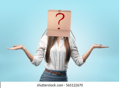 Businesswomen on blue background wearing a carton box on her head with a drawn red question mark. Business and success. Problems and solutions. Getting answers.