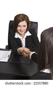 Businesswomen shaking hands in the office.