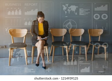 Businesswomen Sitting in Chairs Reading Business Research Papers. Business adviser meeting to analyze and Discussing the Spreadsheet Data on the financial report with charts graphs in the work