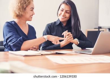 Businesswomen with tablet sitting in meeting room, Negotiation and marketing consulting business concept