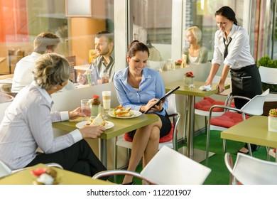 Businesswomen talking business in lunch break cafe happy working showing