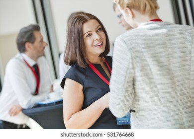 Businesswomen talking during coffee break at convention center