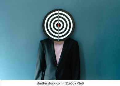 Businesswomen Target Against Their Faces On Blue Background