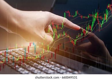 businesswomen using point market trade chart go up on laptop.