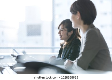 Businesswomen working in the office. Positive workplace concept.