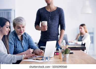 Businesswomen working together on a new campaign using laptop in an advertising agency