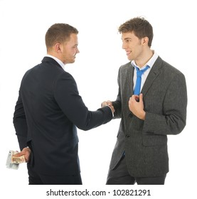 Businnessmen with money behind his back, shake hands