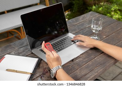 Busniness man hand using e-banking token with laptop on wooden table