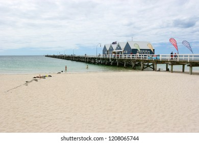 Busselton, Australia - January 20, 2008: People on Busselton beach and Jetty in Western Australia. The jetty is 1.8 km long and is famed for being the longest wooden Jetty in the southern hemisphere.