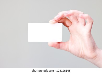bussines card in hand for your information and logo in a grey background