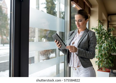 Bussines woman using tablet next to window