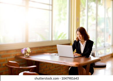 Bussiness concept, Bussiness woman working discussing the charts and graphs showing the results of their successful teamwork, light morning