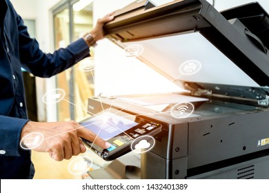 Bussiness man Hand press button on panel of printer with icon technology printer scanner laser office copy machine supplies start concept.
