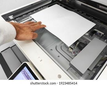 Bussiness man Hand press button on panel of printer, printer scanner laser office copy machine