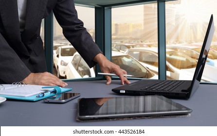 bussiness man working in office with  New Cars in Stock. Car Dealership Cars For Sale background