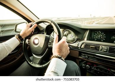 Bussinessman driving luxury car dashboard view