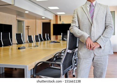 Bust of an anonymous businessman in a meeting room as a business concept