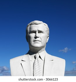 Bust of George Bush sculpture against blue sky in President's Park, Black Hills, South Dakota.