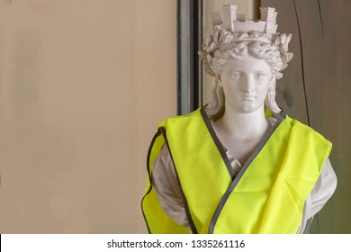 Bust of Marianne, symbol of the French Republic in yellow vest (gilet jaune). France angry