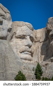 "The bust of President Theodore ""Teddy"" Roosevelt carved Borglum into the Black Hills of South Dakota at Mount Rushmore"