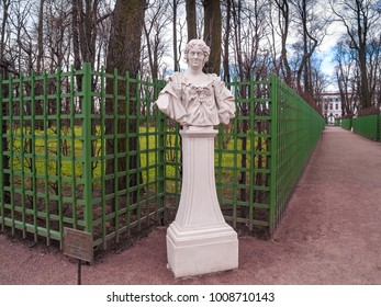 Bust of the sculpture of the woman Maria-Kazemira in the park Summer garden near the green trellis to support the plants in April before the beginning of the summer park season in St. Petersburg