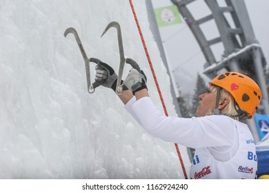 BUSTENI, ROMANIA, February 02, 2010: A woman is climbing frozen mountain at competition in Busteni.