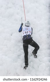 BUSTENI, ROMANIA, February 02, 2010: A man is climbing frozen mountain at competition in Busteni.