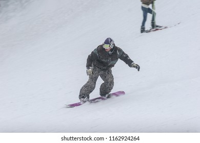 BUSTENI, ROMANIA, February 02, 2010: A man is snow boarding at Busteni mountain.