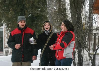 BUSTENI, ROMANIA, February 02, 2010: Three people are having fun in the snow.