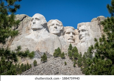The busts of Presidents George Washington, Thomas Jefferson, Teddy Theodore Roosevelt, and Abraham Lincoln carved Borglum into the Black Hills of South Dakota at Mount Rushmore