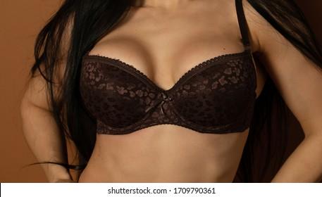 Busty woman bra. Woman in brown lingerie.