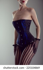 0fcbe7d8c90 Busty woman wearing black and blue corset and lingerie