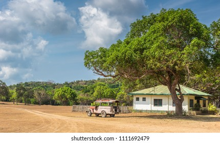 Busuanga Coron, Philippines - March 27, 2018: View of philippino house and old jeep car under the big tree at  Calauit Island, Busuanga, Palawan, Philippines