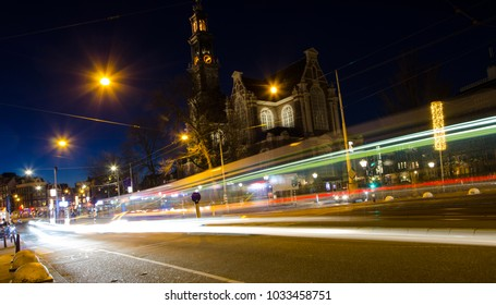 The busy Amsterdam street with light at night
